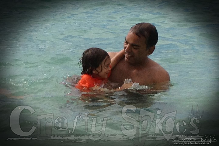 Kira having fun with Tio Cesar at the beach
