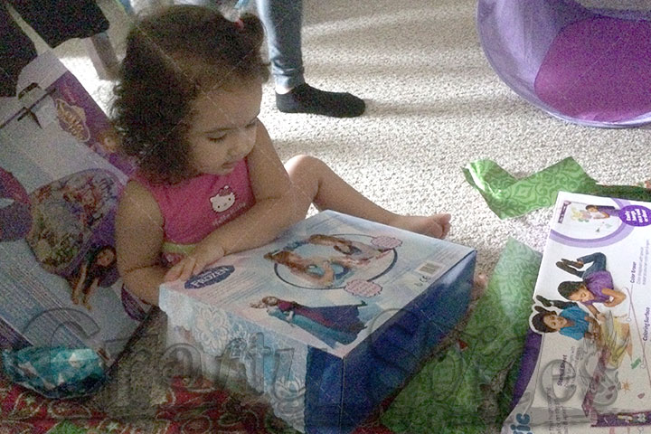Kaylee opening her Frozen gift from Tio