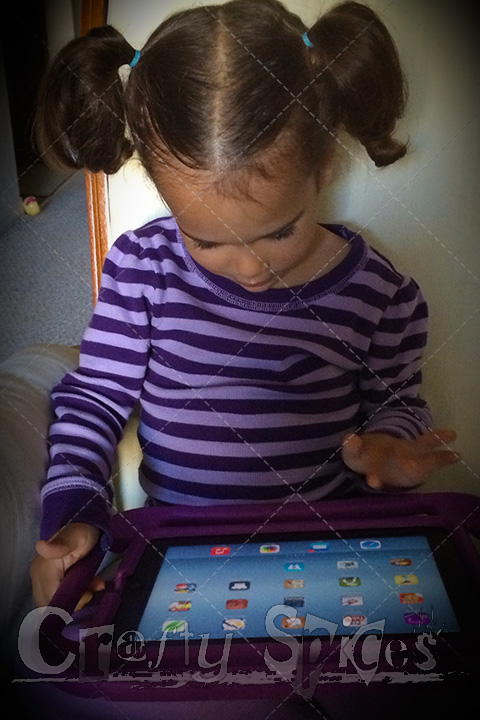 Kira having fun using the iPad with the Gripcase