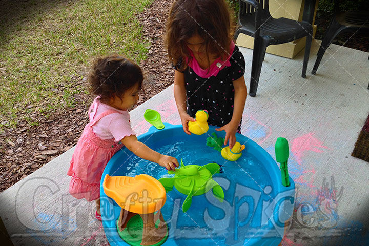 The Girls playing with the Step2 Duck Pond Water Table