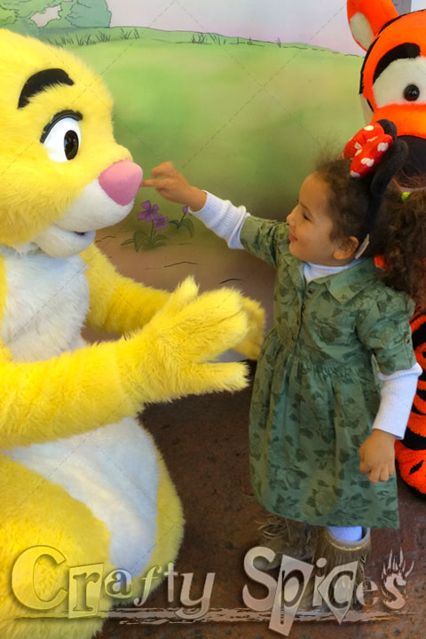 Kaylee with Pooh and friends